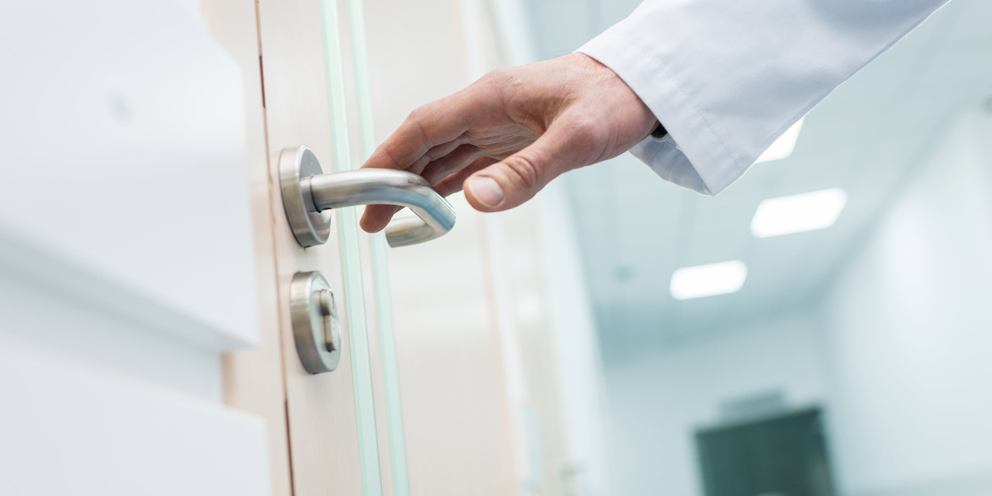 Surface contamination with person touching hospital door.