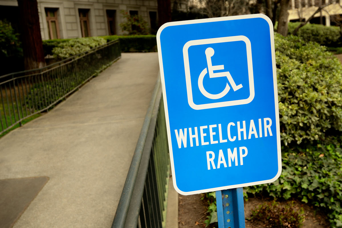 Clear wheelchair accessible ramp signage.