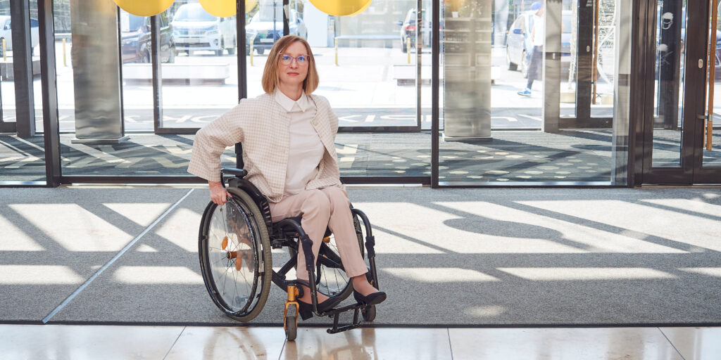 Image of women in a wheel chair to highlight importance of accessibility in business
